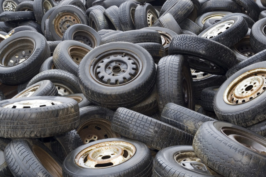 Background of Old worn car tyres on junkyard